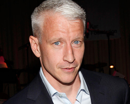 Anderson Cooper got punched in his pretty, pretty face!