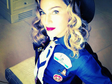 Madonna dressed as a Boy Scout for Anderson Cooper!