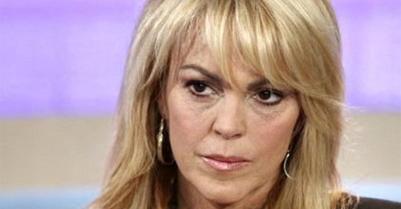 Dina Lohan crashes party, demands a seat for her purse