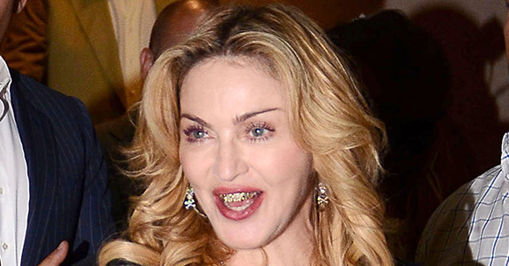 Not Cute: Madonna's new gold grill