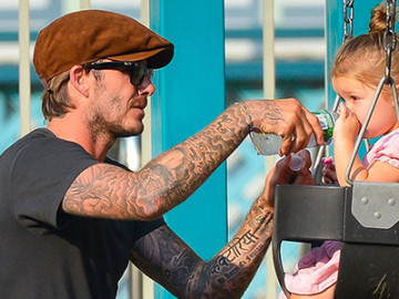 Adorable: David Beckham and his daughter Harper!