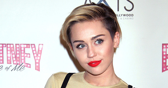 Miley Cyrus is really doubling down with kissing girls!