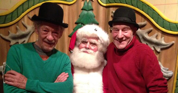Patrick Stewart and Ian McKellen sat on Santa's lap