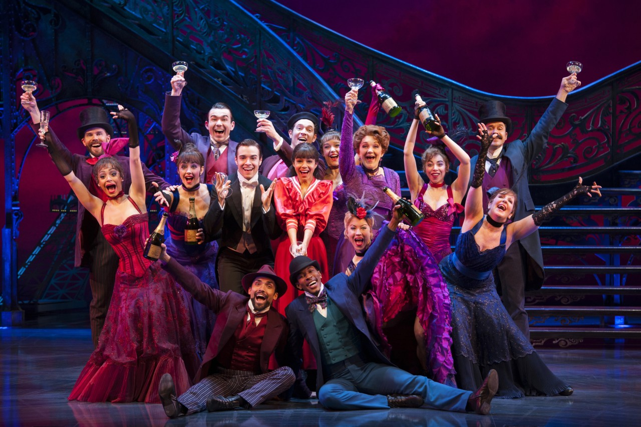 In center (l-r) Corey Cott as Gaston Lachaille, Vanessa Hudgens as Gigi, Victoria Clark as Mamita and Ensemble in the new Broadway production of GIGI, book and lyrics by Alan Jay Lerner, music by Frederick Loewe, adaptation by Heidi Thomas, choreographed by Joshua Bergasse and directed by Eric Schaeffer, at the Neil Simon Theatre (250 West 52nd Street).  © Margot Schulman